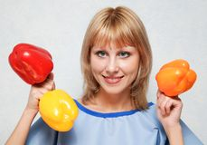 Girl and sweet pepper Stock Images