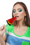 The girl with a sweet. Stock Photography
