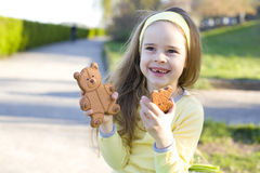 Girl and sweets Stock Images