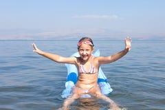 Girl swim on a mattress Royalty Free Stock Photo