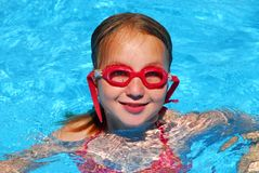Girl swim pool. Young girl in red goggles in a swimming pool Stock Photos