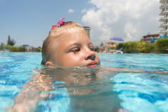 Girl swim in the pool Royalty Free Stock Image