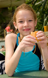 Girl in swim pool eating bread Royalty Free Stock Photo