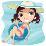 Girl with swim ring in swimming pool. Royalty Free Stock Image