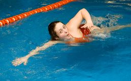 Girl swim in the swimming pool. Athlete girl swim a crawl in the swimming pool Stock Photos