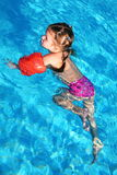 Girl swiming Stock Images