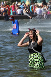 Girl swiming in the fountain Friendship of Nations. MOSCOW, RUSSIA - MAY 18, 2014: Girl swiming in the fountain Friendship of Nations at the All-Russia Royalty Free Stock Image