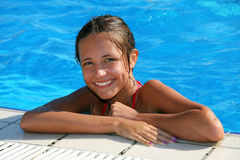 Girl in the swiming pool Royalty Free Stock Image