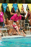 Girl Swimmer Dives Into Pool To Swim Relay Race Stock Images