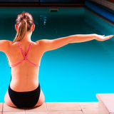 Girl swimmer muscular body  in swimsuit at poolside Stock Photos