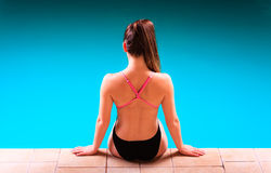 Girl swimmer muscular body  in swimsuit at poolside Royalty Free Stock Photography