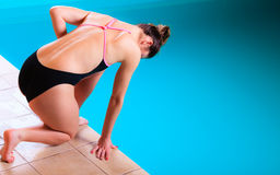 Girl swimmer preparing to  jumping and diving Royalty Free Stock Photos