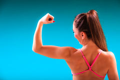 Girl swimmer showing muscles fit body Royalty Free Stock Photos