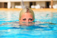 Girl in pool. head half in water stock photography