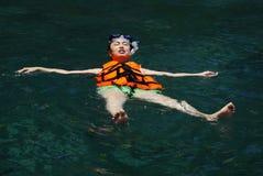 Girl swimming Stock Photography