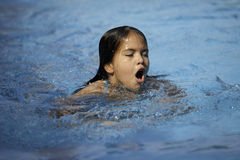 Girl swimming Stock Photos