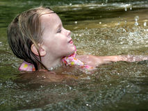 Girl Swimming. Splashing water, hot summers day, who could ask for more Stock Photo