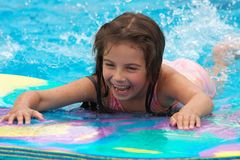 Girl swimming. A little girl swimming in a pool Royalty Free Stock Photo