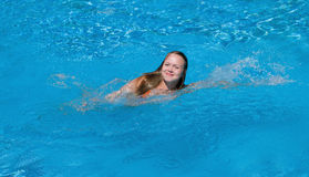 Girl swimming Stock Photography