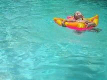 Girl swimming. Girl in the swimming pool Stock Photo