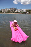 Girl swimming on an air mattress Royalty Free Stock Photos