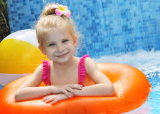 Girl with swimming circle in pool Stock Image