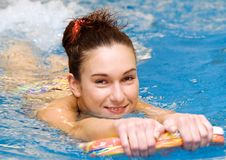 Girl is swimming close-up Stock Images