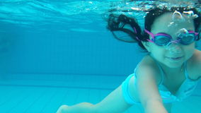 Girl swimming and diving. Underwater shot of girl swimming stock video footage
