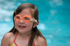 Girl swimming with goggles stock photography