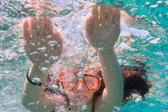 Girl in swimming mask dive in sea near coral reef Royalty Free Stock Image
