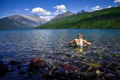 Girl Swimming in Mountain Lake