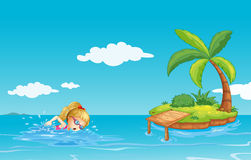 A girl swimming near an island with a coconut tree Stock Photos