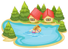 A girl swimming near the pine trees Royalty Free Stock Images