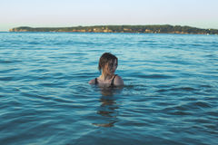 Girl swimming in ocean Stock Images
