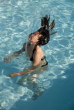 Girl in a swimming pool. Young girl having fun in a swimming pool and with her hair Stock Images