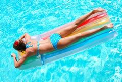 Girl in swimming pool. Girl in resort swimming pool Royalty Free Stock Images