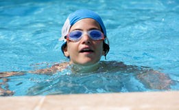 Girl in the swimming pool Royalty Free Stock Image