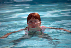 Girl swimming in pool Stock Photo