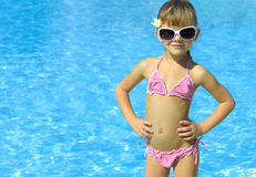 Girl in the swimming pool Stock Photos