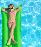 Girl in the swimming pool. In  sun glasses Stock Photos