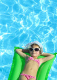 Girl in the swimming pool. In hat and sun glasses Royalty Free Stock Photography