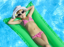 Girl in the swimming pool Stock Photography