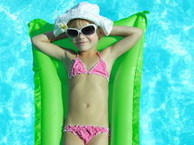 Girl in the swimming pool stock images