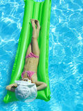 Girl in the swimming pool. Girl in the swimming in hat and sun glasses Stock Photos