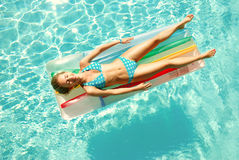 Girl in swimming pool Stock Photography