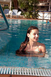 Girl in swimming pool. Smiling teenage girl in the swimming pool of luxury hotel Stock Photography