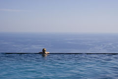 Girl in swimming pool royalty free stock image