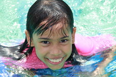 Girl at a swimming pool. Close up picture of a cheerful pretty girl at a swimming pool Royalty Free Stock Image