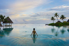 Girl in the swimming pool. In maldives resort Royalty Free Stock Images