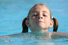 Girl swimming in the pool. (copyspace on the left Stock Photo